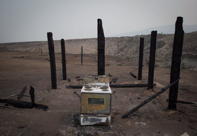 A stove sits among the remains of a structure that burned in a wildfire on the Ashcroft First Nation...