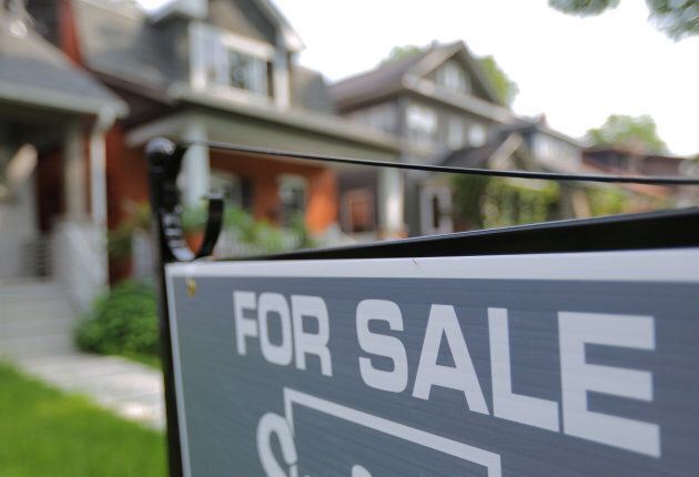 A sign advertises a house for sale in midtown Toronto, Ontario, July 12, 2017. More than half of analysts polled by Reuters in May said a sharp housing slowdown is somewhat or very likely in Canada.