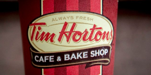 Restaurant Brands International Inc. says it has signed a deal with a joint-venture partner to take Tim...