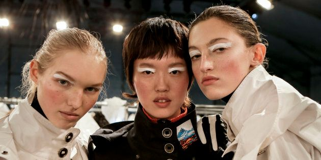 (L-R) Jess PW, model and Amber Witcomb pose Backstage prior the Kenzo Menswear Fall/Winter 2017-2018...