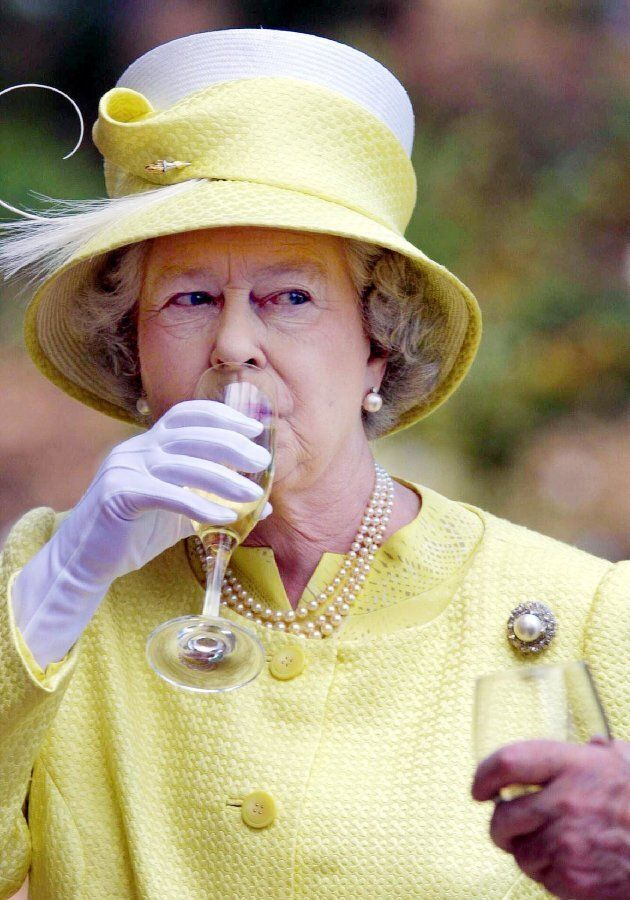 British's Queen Elizabeth II samples a Barrosa wine while visiting Chateau Barrosa in Adelaide, 28 February...