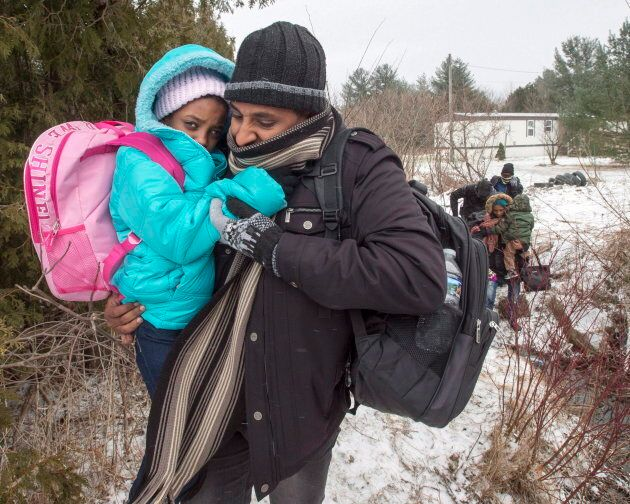 A group of refugee claimants from Eritrea cross the border from New York into Quebec on March 2,