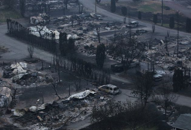 The remains of the Boston Flats trailer park is pictured after being destroyed by a wildfire in Boston...