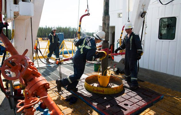 Oil rig floorhands work on an oil rig near Fort McMurray, Alta.