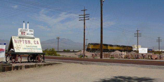 A photo of the railroad crossing in Nipton, Calif. Cannabis company American Green has bought the town's...