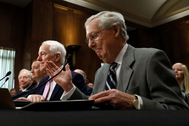 U.S. Senate Majority Leader Mitch McConnell attends a committee hearing in support of U.S. President...