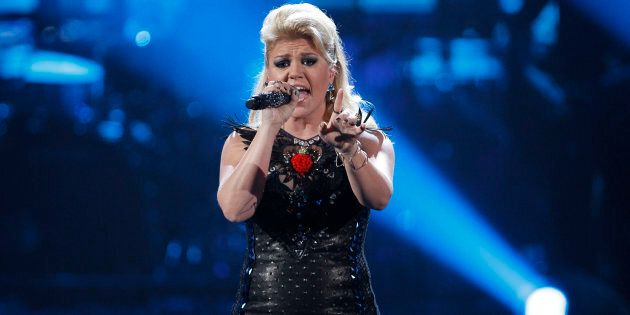 Kelly Clarkson performs a medley of songs at the 40th American Music Awards in Los Angeles, November...
