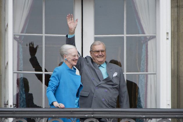 Denmark's Queen Margrethe and Prince Henrik wave from the balcony during Queen Margrethe's 76th birthday...