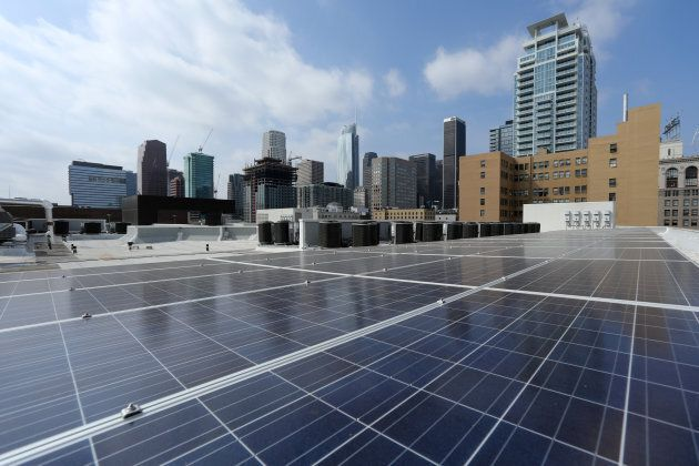 Solar electric panels are shown installed on the roof of the Hanover Olympic building, the first building...