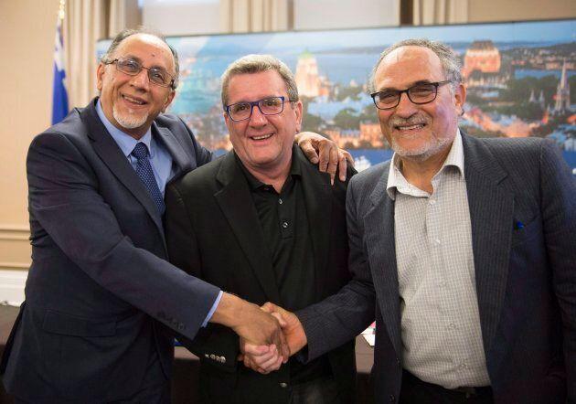 Boufeldja Benabdallah, interim coordinator at the Centre Islamique de Quebec (left), Quebec City mayor...
