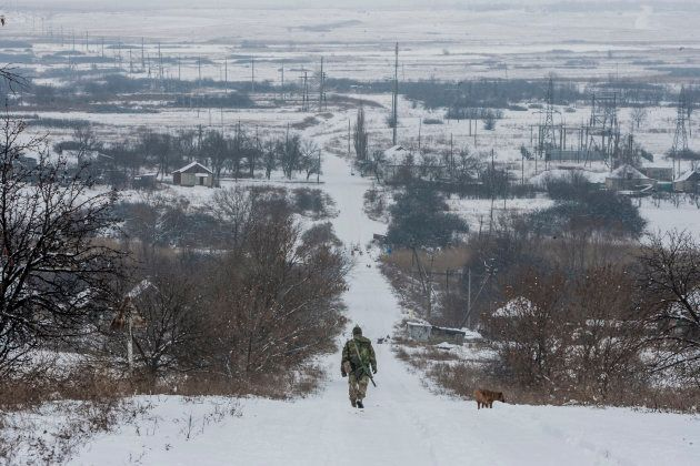 A file image of a Ukrainian soldier patrolling near Troitske, one of the closest villages to the eastern...