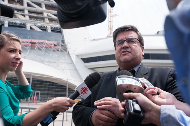 The Mayor of Montreal Denis Coderre speaks to the media as a bus of Haitian asylum seekers from the United...