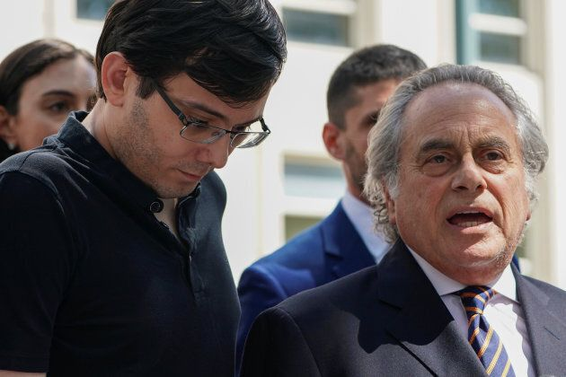 Former drug company executive Martin Shkreli stands with his attorney Benjamin Brafman after exiting...