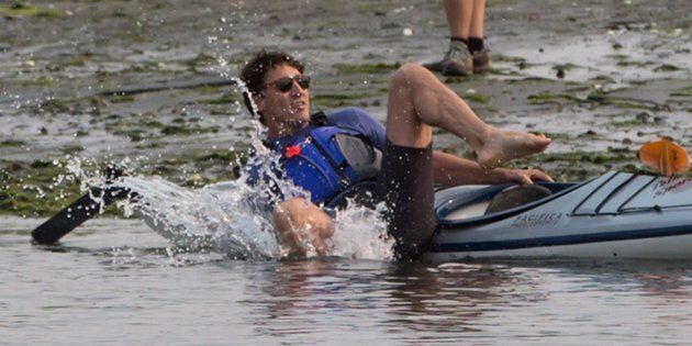 Prime Minister Justin Trudeau falls into the water while trying to get into a kayak at Sidney Spit in...