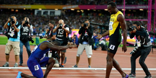 Usain Bolt of Jamaica with Justin Gatlin of the U.S. at the World Athletics Championships on August 5,...