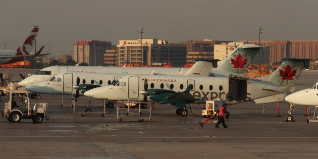 Air Canada Express commuter airplanes are serviced at their gates at Toronto Pearson International Airport...