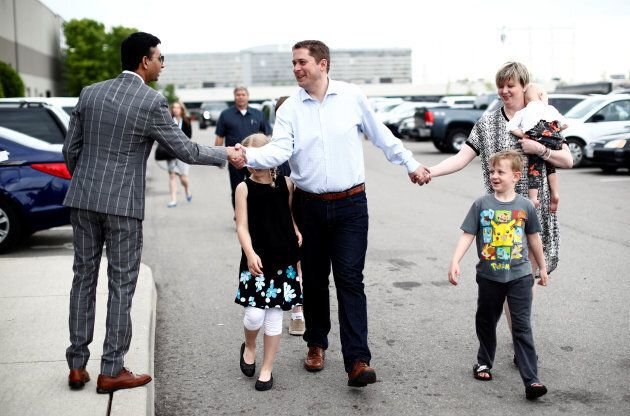Conservative leadership candidate Andrew Scheer arrives with his wife Jill and family at the Conservative...