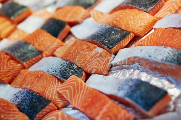 Traditional salmon fillets being sold at a farmer's market.