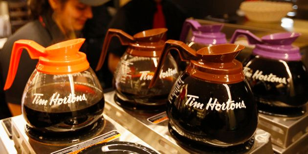 Tim Hortons employees prepare coffee before the company's annual general meeting in Toronto on May 8,