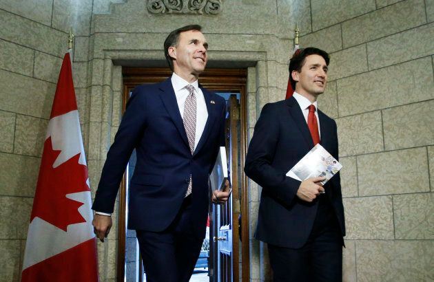 Prime Minister Justin Trudeau and Finance Minister Bill Morneau walk from Trudeau's office to the House...