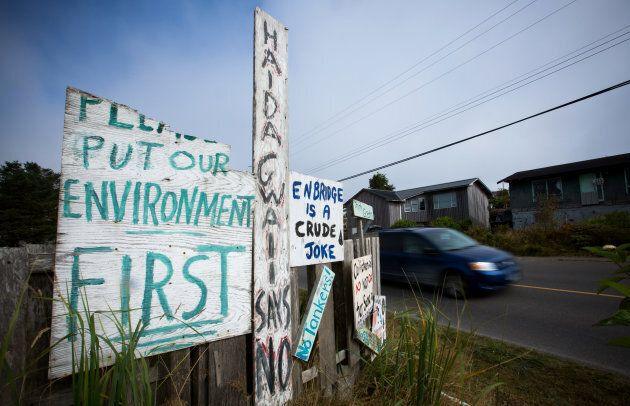 Handmade anti-pipeline signs are seen on the side of a road in the First Nations village of Old Massett,...