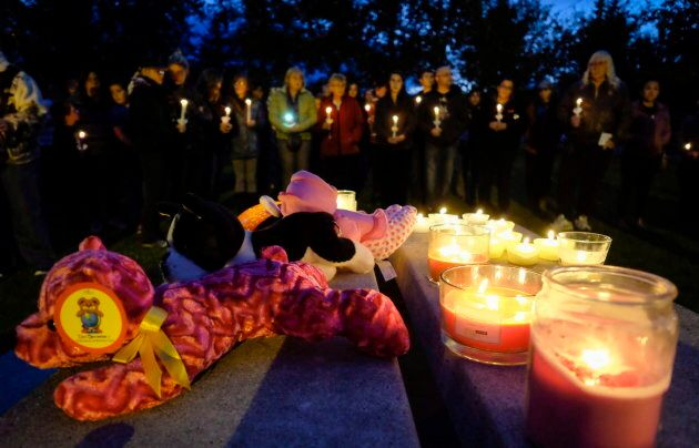 Residents gather for a candlelight vigil for Hailey Dunbar-Blanchette in Blairmore, Alta., Tuesday, Sept....