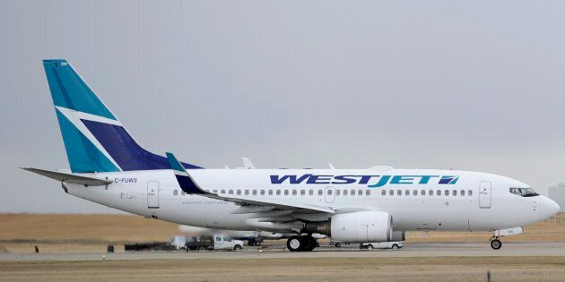 A WestJet plane takes off at the International Airport in Calgary on May 3,