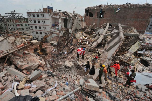 Rescue workers attempt to find survivors from the rubble of the collapsed Rana Plaza building.