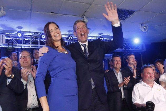 Brian Pallister and his wife Esther celebrate his party's election victory with candidates and supporters...