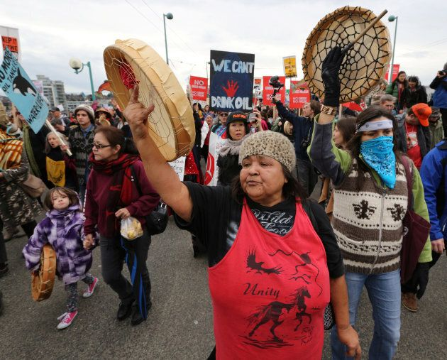 First Nations citizens chant slogans during a protest march against the proposed expansion of Kinder...