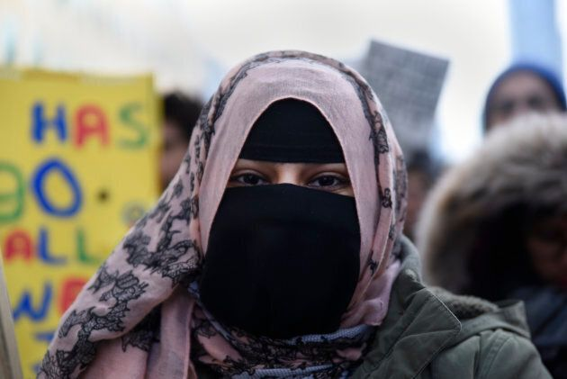 """A Muslim woman wearing """"burqa"""" during a rally against Islamophobia & White Supremacy in Toronto, Ont., on Feb. 4, 2017."""
