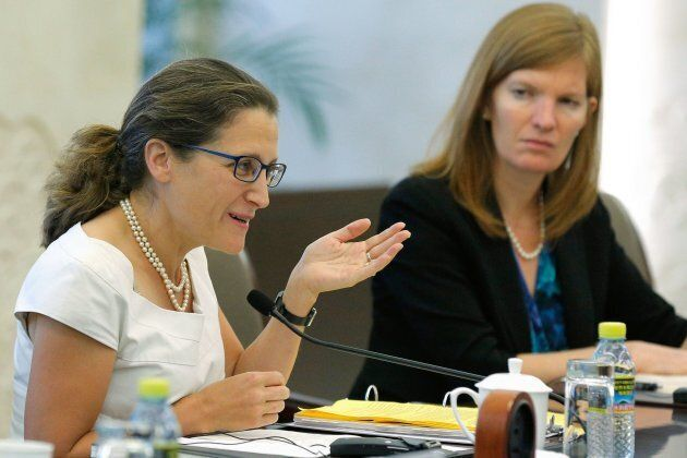 Foreign Affairs Minister Chrystia Freeland (L) gestures as she speaks with her Chinese counterpart Wang...