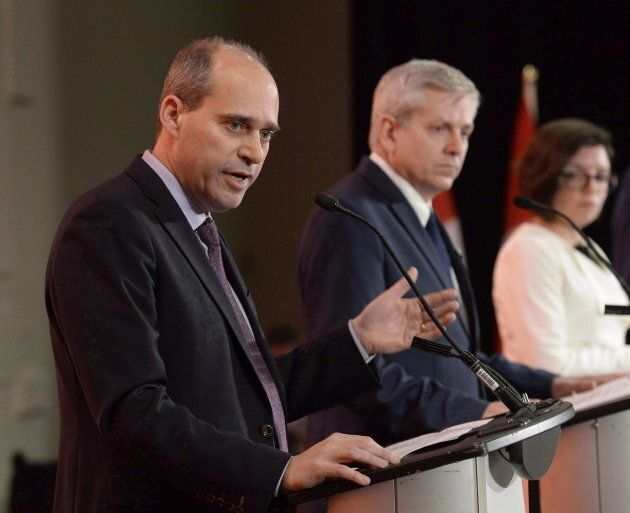 Guy Caron, left, speaks as Charlie Angus and Niki Ashton look on in the first debate of the federal NDP...