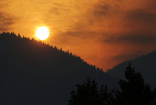 B.C.'s wildfires have caused air quality warnings throughout the province. The sun is pictured through...