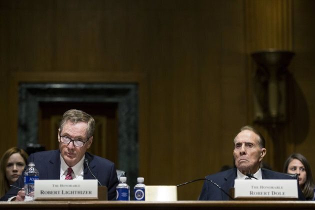Robert Lighthizer, U.S. trade representative nominee for President Donald Trump, and former Senator Bob Dole, right, listen during a Senate Finance Committee confirmation hearing in Washington, D.C., U.S., on March 14, 2017.