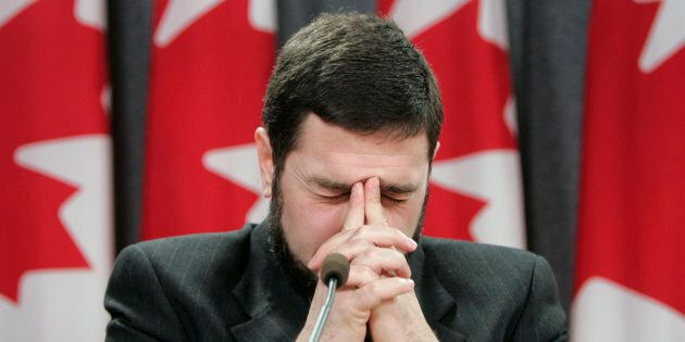 Maher Arar pauses during a news conference in Ottawa, Ont. Jan. 26,
