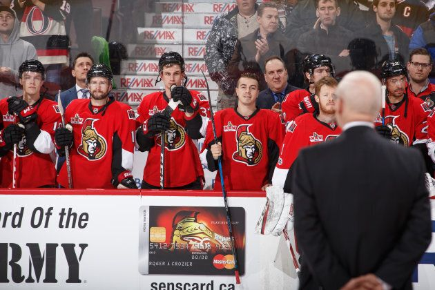 Ottawa Senators players look on as Bryan Murray is named the first inductee into the Ottawa Senators...