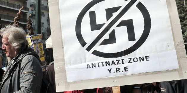 Anti-racist and anti-nazi activists gather outside the appeals court in Athens during the appearance...