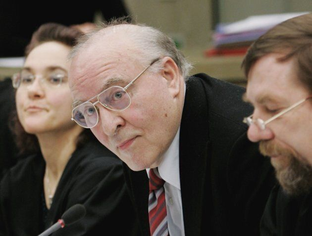 Holocaust denier Ernst Zuendel (C) and his lawyers arrive for his reopened trial on Feb. 9, 2006 in Mannheim,...