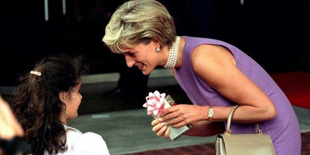 Diana, Princess of Wales, thanks a young girl for the gift she gave her outside the Commonwealth Day...