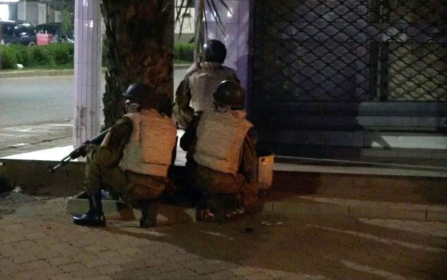 Soldiers surround a restaurant following an attack by gunmen on the restaurant in Ouagadougou, Burkina...
