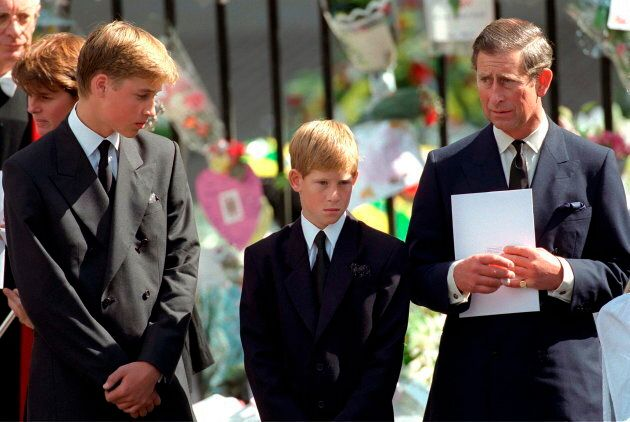 Prince William and Prince Harry with Prince Charles at Westminster Abbey for the funeral of Diana on...