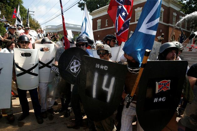 White supremacists stand behind their shields at a rally in Charlottesville, Virginia, U.S., Aug. 12,