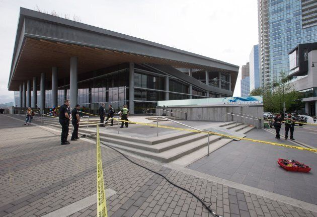 Ramps for a motorcycle stunt are seen on the steps outside the Vancouver Convention Centre while police...