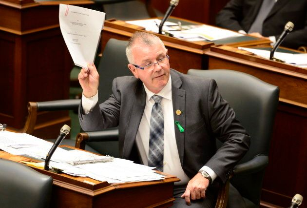 Ontario Labour Minister Kevin Flynn in the legislature at Queen's Park in Toronto on May 25,