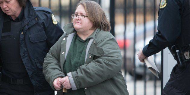 Elizabeth Wettlaufer is escorted into the Woodstock courthouse.