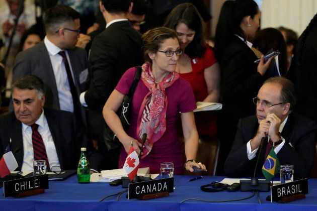Canadian Foreign Minister Chrystia Freeland (C) takes a seat next to Brazilian Foreign Minister Aloysio...
