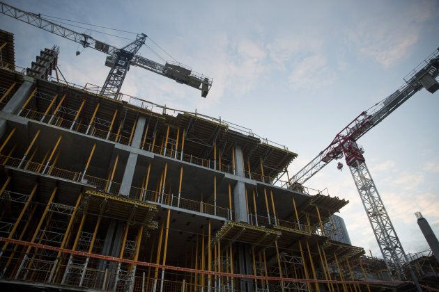 Cranes operate at a condominium under construction in Toronto, Ont., on Saturday, May 27,
