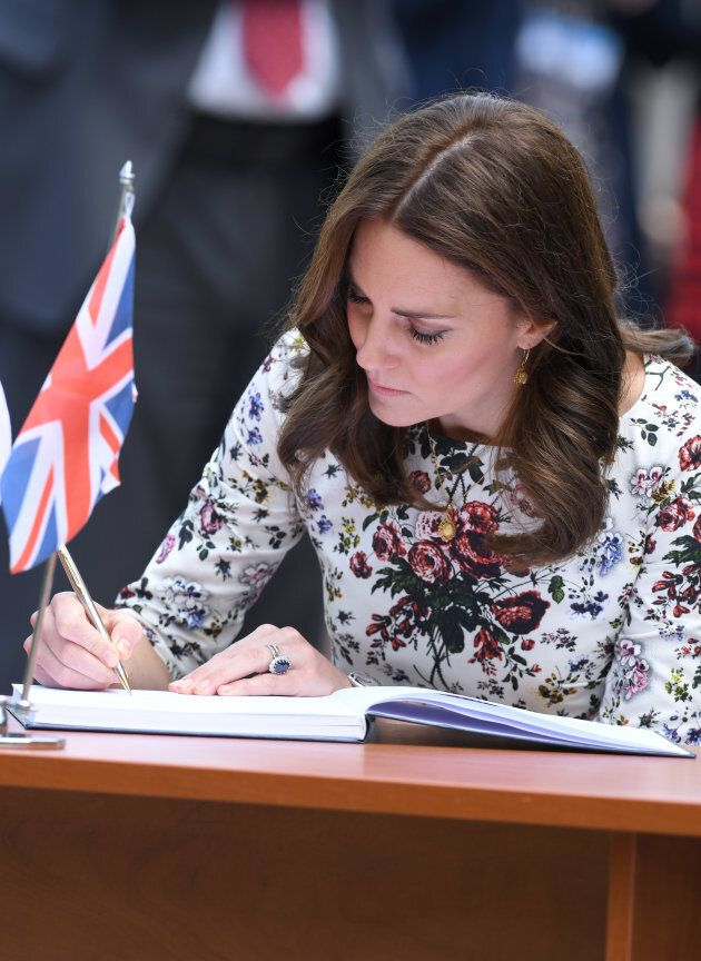 Catherine, Duchess of Cambridge visits a former Nazi Germany Concentration Camp during day 2 of their...