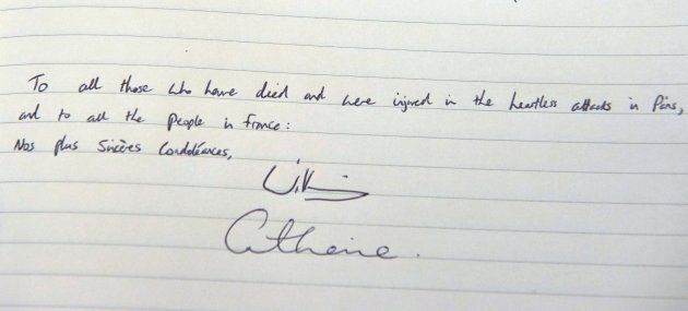 The message written by Britain's Prince William, Duke of Cambridge and also signed by Catherine, Duchess...
